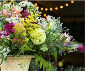 A Late Summer Fete: Sign-in table arrangement for Tricia & Bradley's summer wedding.