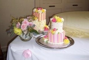 It's a Girl: Sweet floral centerpieces perfectly complement the cake for this charming baby shower.